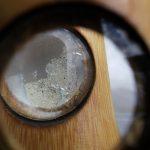 Zandkorrels onder een microscoop